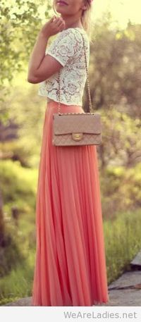 Lace cut-off blouse paired with coral maxi skirt