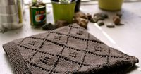 P1020841 by narangkar, via Flickr - Beautiful brown knit blanket with diamond motifs