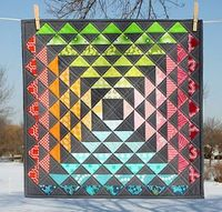 This stunner was a finalist in the Modern Mini Quilt Challenge. It was created by Lee of Freshly Pieced.