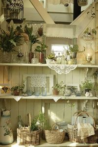 lovely shelves-love the use of doilies