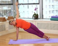 Kathryn Budig shows you how to step up your plank for a whole lot of awesome.