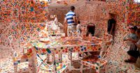 "Yayoi Kusama ""The Obliteration Room"" Painted an entire 'interior' white and then let loose children with colored stickers"