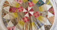 camelot quilt by lizzie broderie, via Flickr. Love the quilting, fabric choices, other blocks too!