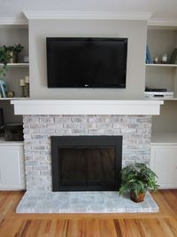 If your brick fireplace is in need of a face lift, and removing the brick isn't a viable option for you, whitewashing your existing brick is a great alternative