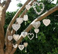 Decorations to hang from tree outside or walls Can you make things like this for the arch way?