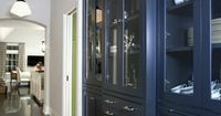 Navy blue cabinets paired with an antique rug