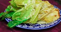 """Grilled romaine hearts-- """"Because the grill caramelizes the lettuce, there's no need for added dressing which makes it low in fat/calories and high in flavor!"""" 