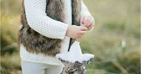 sweater, leggings, and boots with faux fur vest - cute winter outfit for a girl