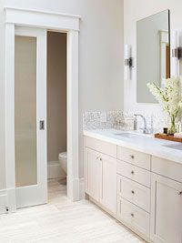 Small Bathroom Remodel: An Airy Retreat frosted glass door on bathroom