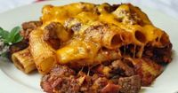 Steak and Bacon Pasta Bake - made with spicy quick tomato compote and cheddar cheese. This easy workday meal is what can happen at our house when we clean the past few days' leftovers out of the fridge.