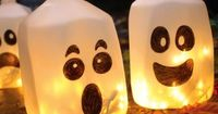 CRAFTS: 25 Halloween Projects (Just my own thought to go with this picture. Use an empty milk jug, decorate, fill with water & add green or blue Glow sticks instead!!)