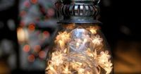 Decor and Details / Lantern filled with a strand of battery-operated Christmas lights. Perfect for candle-phobic venues!