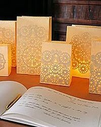 Give the decorations at your wedding reception the romantic look of lace. The intricate patterns shining through these luminarias (paper-bag lanterns illuminate