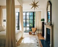White provides the backdrop for the entirety of designer Tabitha Simmons and her husband Craig McDean's Chelsea townhouse, and the bedroom is no exception, allowing details like the Tom Dixon paper star lantern and the 19th-century Victorian mirror ...