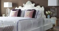 Lovin the mirrored nightstands and the headboard