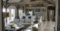 open flowing living space with pale greige beams, lovely detail in floor...