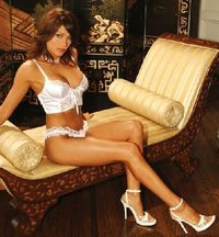 Elegant Moments Lingerie 5880 Sexy white satin cami with adjustable straps, underwired cups with lace insertions on top, front lace panel and chic lace-up with tone-to-tone satin ribbon and metallic grommets. The cami features bon http://www.comparestorep...