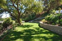 Benefits of dry-laid stone retaining walls: They resist fire, water and insects. They can be recycled due to the dry-laid method. They provide natural drainage without any damage to the structure, unlike mortared walls, which tend to crack and break into ...