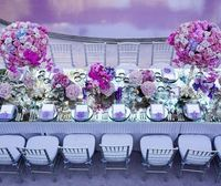 Metallic accents reflect bold pink and purple arrangements of roses, hydrangeas and hot pink orchids.