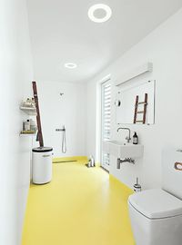 The budget was nearly as tight as the space in this cheerful 516-square-foot flat in Bratislava.