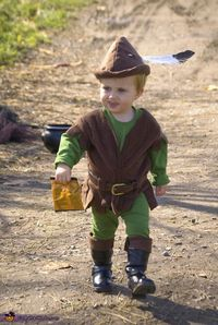 Amanda: It's the Errol Flynn Robin Hood version complete with mustache. We used brown fleece, a long sleeved green shirt and green pants, fleece tunic, leather belt cut to fit, complete...