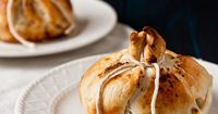 Tart Granny Smith apples are baked with a cinnamon and sugar mixture inside a flaky pastry crust.