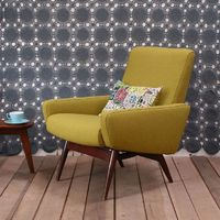 love this groovy vintage greenish yellow chair against the gray and white textured mod walls