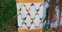 Hands up if you love the Aztec trend?! Me!Me!Me! I love the colours, I love the geometric patterns, I love it all! This quilt fits right in with the trend. To m