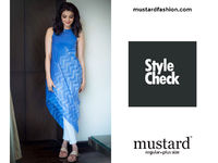 Celebrity style check with mustard fashion brand.