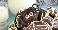 Candy eyes & licorice legs turn these soft Chocolate Pumpkin Spider Donuts into a fun yet creepy treat to share at Halloween parties.