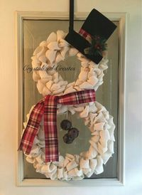 Cute white burlap snowman wreath with a plaid scarf and top hat.jpeg