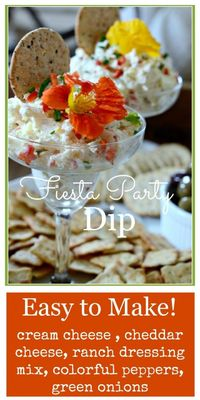 Here'a recipe that makes entertaining easy and delicious all at the same time! Fiesta Party Dip is creamy, cheesy, filled with colorful peppers and has that scr