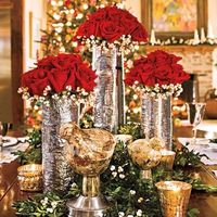 Rose bouquets in tall vases or candles floating on top of single flowers?