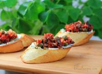 Crostini with Sun-Dried Tomato Tapenade and Herbed Goat Cheese