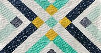 """Pretty """"Retro Plaid"""" quilt (free pattern after the jump) by Suzy Quilts for Birch Fabrics."""
