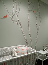 Modern Artistic Baby Room nursery interior design. I like the tree in particular.