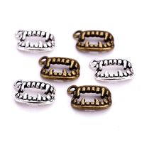Pack of 20 Dracula Vampire Teeth Fangs Charms. Bronze or Silver Halloween Pendants. 15mm x 11mm. £5.99