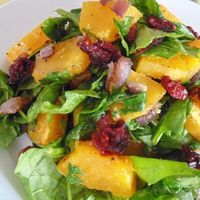 Roasted Butternut Squash with Onions, Spinach, and Craisins® | 'I peeled the squash with a potato peeler first and cut into cubes; a lot easier I think. Recipe was good and I'm always looking for recipes to fix butternut squash as they grow abund...