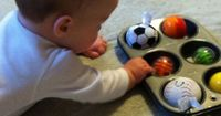 Baby Play Activity with a Muffin Tin and Rattle Balls {Tummy Time}