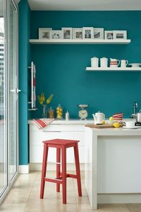 Explore our kitchen ideas, including these teal blue walls against the high gloss white cabinets