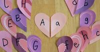 There are so many fun crafts and games to play with hearts. They are the perfect shape. We're using hearts in our letter matching game today. I printed out anot