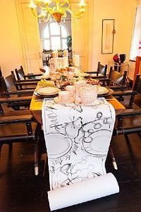 what a fun idea...a hand sketched table runner. or just leave sharpies out for your guests to make their own art.