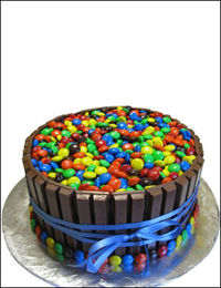 Send a new cake design , Smarties and KitKat Cake.