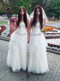 Here come the brides: 'Androgyne' husband and wife both wear dresses to Moscow registry office wedding in precedent that has confused anti-gay administration