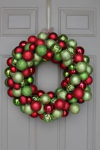 With only one week till Christmas, I wanted to share how to make a DIY ornament wreath to bring colour and festive cheer at your doorstep or in your home. Here'