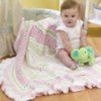 Embellished with lovely ruffles and popping with precious pink hues, this Ruffled Baby Blanket is the perfect way to curl up with your little one! Easy enough f