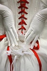 Use ribbon in your wedding color to lace up your dress for a unique touch