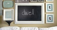 would love a photo wall EXACTLY like this in our game room/second family room when we have one{someday} hahaha