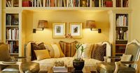 Put the Walls to Work Built-in bookcases define a niche for a daybed-style sofa in this petite living room. Wall lamps illuminate the niche, creating a cozy feeling as well as providing reading light. A pair of fauteuils (French-style open-arm chairs&...