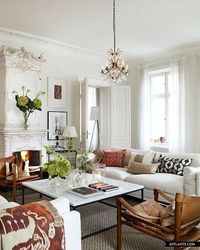 white living room with pops of color and pattern
